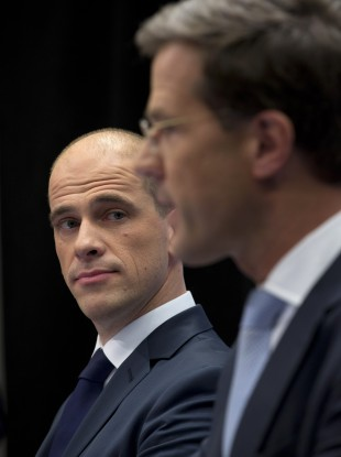 Liberal premier Mark Rutte, right, and Labour's Diederik Samsom attend a joint news conference in The Hague.