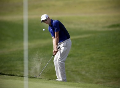 Britain's Ross Fisher chips the ball onto the fifth green during the first round of the Portugal Masters golf tournament at the Victoria golf course in Vilamoura.