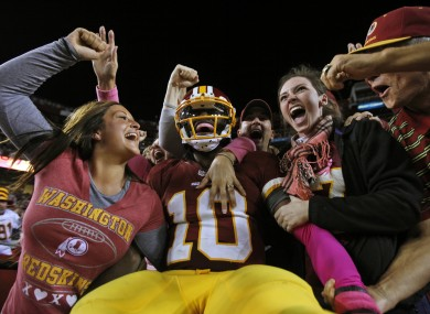 RG3 celebrates with Redskins fans after running in a 76-yard touchdown on Sunday.