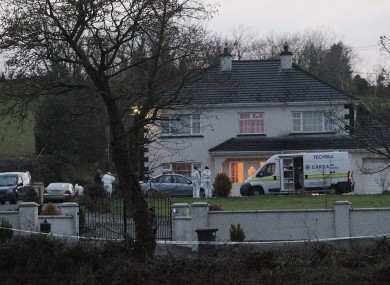 Gardai attend the scene after the body of John Kerins was discovered in the large detached two-storey house in the townland of Cornaveagh, near Bailieborough, Co Cavan