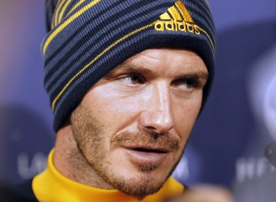 Los Angeles Galaxy's David Beckham talks with reporters during a news conference.