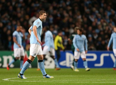 Manchester City's Edin Dzeko and his team-mates stand dejected during this week's Champions League tie with Real Madrid.
