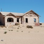 Some are completely buried in sand as the desert slowly swallows up the mining town.