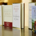Editions in different languages of Pope Benedict XVI's new book displayed during its official presentation. (AP Photo/Gregorio Borgia)