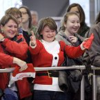 Bernadette Hynes, centre, sees her son Karl and Imelda O'Reilly sees her daughter Colette pass through the arrivals gate together after traveling home from Adelaide for Christmas today at Dublin Airport. Photo: Mark Stedman/Photocall Ireland