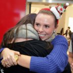 Donna Hayes (25) from Cork is greeted by cousin Caoimhe Dulla after traveling home from Singapore for Christmas today at Dublin Airport. Photo: Mark Stedman/Photocall Ireland