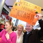 Niamh Bohan (23) from Cork City is a little embarrassed by her parents Noel and Yvonne after traveling home from Singapore for Christmas today at Dublin Airport. Photo: Mark Stedman/Photocall Ireland