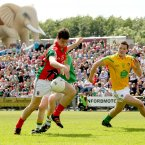 Mayo's Alan Freeman scores his sides opening goal of the game as the crowd watches on and a large inflatable elephant, courtesy of supporters Elvery's, looms behind the stand in McHale Park. (INPHO/James Crombie).