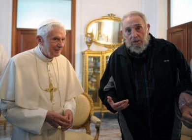 Pope Benedict XVI meets with Fidel Castro hanging in Havana last March.
