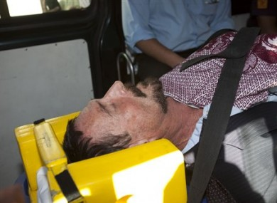 McAfee in an ambulance on his way to hospital.