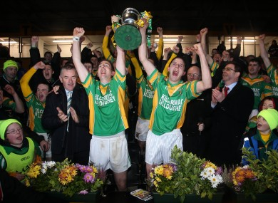 ilcormac captain Ciaran Slevin (left) and John Grogan lift the cup.