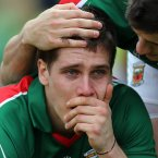 A different picture. Mayo defender Lee Keegan is crestfallen after losing out on All-Ireland glory. (INPHO/Donall Farmer).