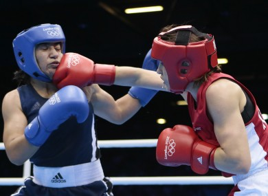 Ireland's Katie Taylor lands a punch on , fights Tajikistan's Mavzuna Chorieva during their lightweight 60-kg semifinal boxing match at the 2012 Summer Olympics