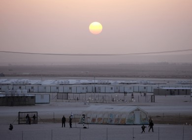 Young Syrian refugees play football at the Zaatari refugee camp in Jordan on Christmas Day.