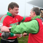 Landing the Holy Grail. St Brigid's charismatic goalkeeper Shane Curran embraces manager Kevin McStay after winning his first Connacht medla on the field of play at 41 years of age. (INPHO/Mike Shaughnessy).