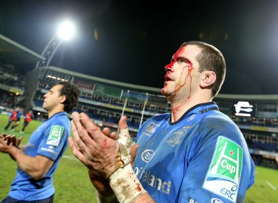 A bloodied Shane Jennings applauds Clermont off the field.