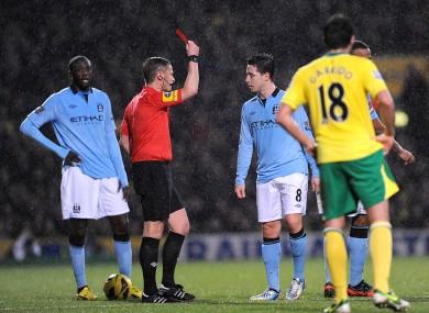 Manchester City's Samir Nasri (8) is sent off by match referee Mike Jones (second left)