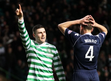 Celtic's Gary Hooper (left) celebrates his first goal during the Clydesdale Bank Scottish Premier League match at Celtic Park.
