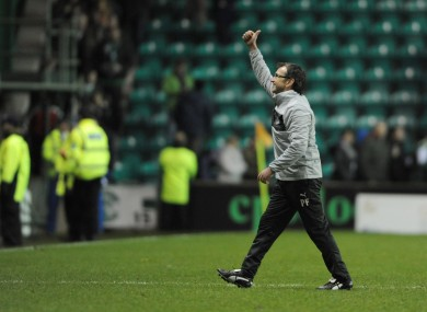 Pat Fenlon acknowledges the cheers of the home supporters.