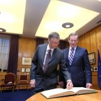 Bill Gates signs the visitor book at Government Buildings today with Enda Kenny. (Sam Boal/Photocall Ireland)