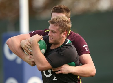 Chris Henry wrestles for possession with Ulster teammate Iain Henderson.