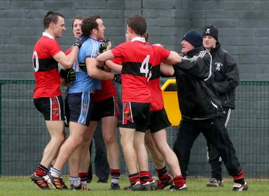 UUJ's Emmett McGuckian gets involved with UCC manager Billy Morgan.