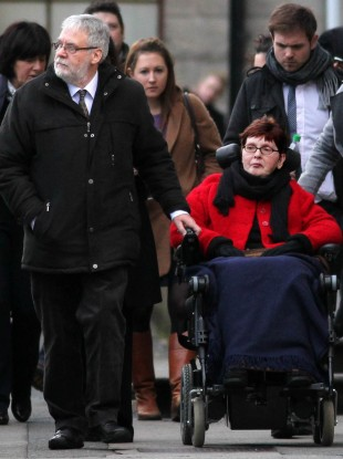 Terminally-ill Marie Fleming leaving the High Court in Dublin, with her partner Tom Curran, where has pleaded with judges to spare her a horrible death and let her be helped to die lawfully with dignity.