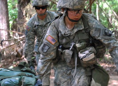 In a 9 May, 2012 file photo, Captain Sara Rodriguez, 26, of the 101st Airborne Division, carries a litter of sandbags during the Expert Field Medical Badge training at Fort Campbell, Kentucky.