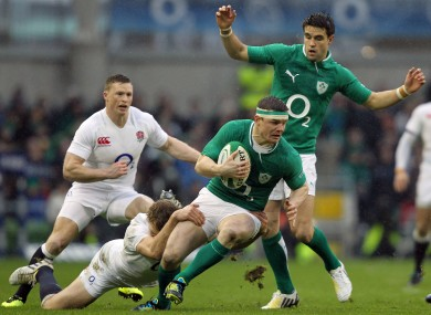 Brian O'Driscoll is tackled by Billy Twelvetrees.