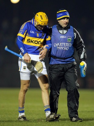 Tipperary's Shane McGrath leaves the game with a hand injury.
