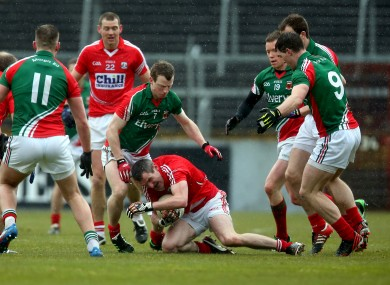 Cork's Graham Canty battles against the Mayo defence.