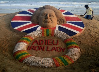 Indian sand artist Sudarshan Pattnaik gives finishing touches to his sand sculpture at the golden beach of Puri
