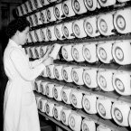 A worker checks every single clock face being manufactured at Smiths Ltd in 1948. (Barratts/S&G Barratts/EMPICS Archive)
