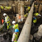 Archaeologists work to unearth Roman artifacts from a construction site at Bloomberg Place in the financial district of London. The site, which was once home to the Roman Temple of Mithras and situated on the lost Walbrook stream, is to be the new headquarters of Bloomberg. (Image: Dominic Lipinski/PA Wire)