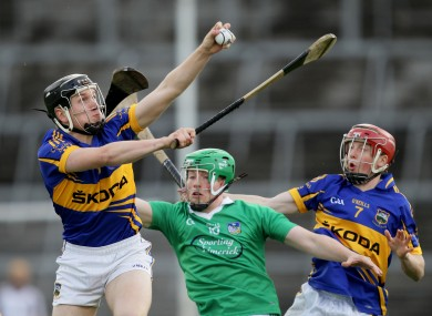 Tipperary's Dan McCormack with teammate Justin Cahill and Limerick's Shane Dowling.