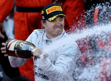 Nico Rosberg showers his pit crew with winners' champagne.