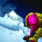 Dawson Stelfox on the summit ridge, just beyond the First Step, checking theoxygen. (Frank Nugent)