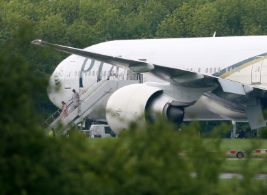 Passengers disembark the Pakistan International Airlines flight after its unscheduled arrival in Stansted this afternoon.