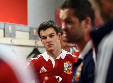 Jonny Sexton listens to Andy Farrell in the Lions dressing room.