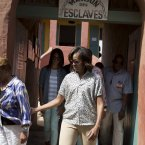 First lady Michelle Obama leaves a tour of Goree Island on Thursday, June 27, 2013, in Goree Island, Senegal. Goree Island is the site of the former slave house and embarkation point built by the Dutch in 1776, from which slaves were brought to the Americas. From left, Marian Robinson, Malia Obama, and Michelle Obama. (AP Photo/Evan Vucci)
