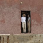 U.S. President Barack Obama and first lady Michelle Obama stand together in the 'Door of No Return,' at the slave house on Goree Island, in Dakar, Senegal, Thursday, June 27, 2013. Obama is calling his visit to a Senegalese island from which Africans were said to have been shipped across the Atlantic Ocean into slavery, a 'very powerful moment.' President Obama was in Dakar Thursday as part of a weeklong trip to Africa, a three-country visit aimed at overcoming disappointment on the continent over the first black U.S. president's lack of personal engagement during his first term.(AP Photo/Rebecca Blackwell)