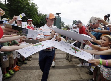 McIlroy signs autographs for fans during practice for the US Open.