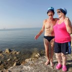 Caroline Farrell and James Cove cool off today at Seapoint... We think this would make a great caption competition - all suggestions in the comments section below. Photo: Mark Stedman/Photocall Ireland