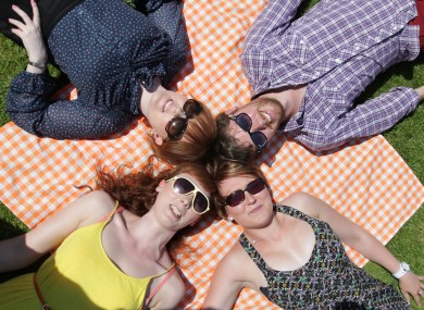 Pictured, clockwise from bottom right, Laura Farrell, Hilary Hughes, Aisling Cronin and Aaron Corr soak up the sun today in Merrion Square, Dublin, 9 July 2013