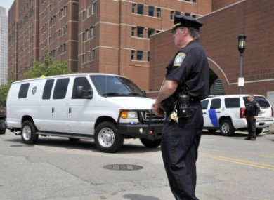 A U.S. Marshal's van, believed to be carrying Boston Marathon bombing suspect Dzhokhar Tsarnaev, arrives at the federal courthouse.