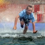 Joshua Prentice, aged eight from Belfast, inside a water ball at the Dalriada Festival at Glenarm Castle, Co. Antrim.
