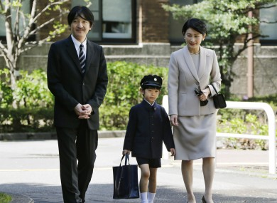 Prince Hisahito (centre) with his parents at his school in Tokyo