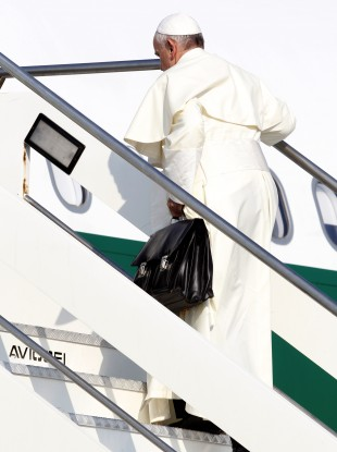 Pope Francis boards a plane at Rome's Fiumicino airport this morning