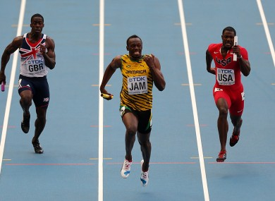 Jamaicia's Usain Bolt (centre) wins the 4x100 metres relay final.
