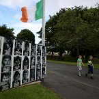 A placard commerating IRA volunteers in a housing estate  in Castlederg. Pic: Julien Behal/PA Wire